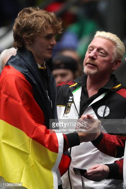 Alexander Zverev of Germany celebrates victory with Borsi Becker after the double match between Tim Puetz and JanLennard Struff of Germany and Gabor...
