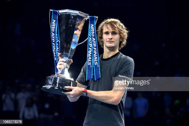 Alexander Zverev of Germany celebrates victory with the trophy following the singles final against Novak Djokovic of Serbia during Day Eight of the...