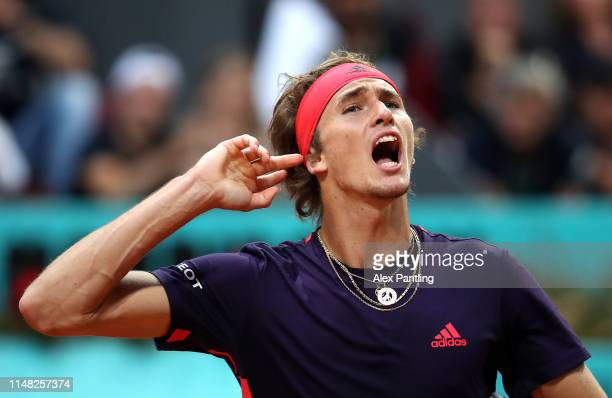 Alexander Zverev of Germany celebrates winning a game in his men's singles quarterfinal match against Stefano Tsitsipas of Greece during day seven of...