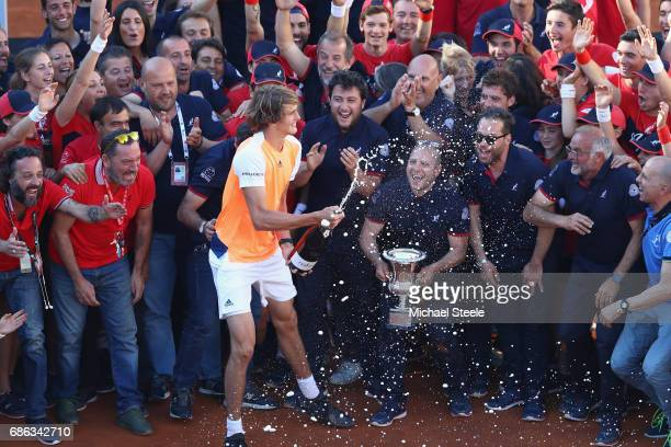 Alexander Zverev of Germany celebrates with ball boys line judges and groundstaff after his victory in the men's Final against Novak Djokovic of...