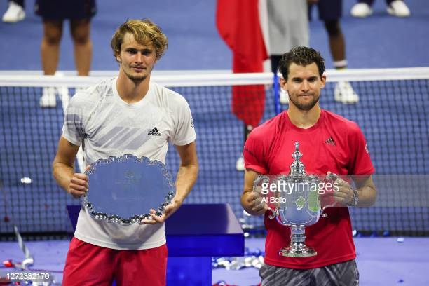 Alexander Zverev of Germany celebrates with his finalist trophy alongside Dominic Thiem of Austria with his championship trophy after Thiem won in a...