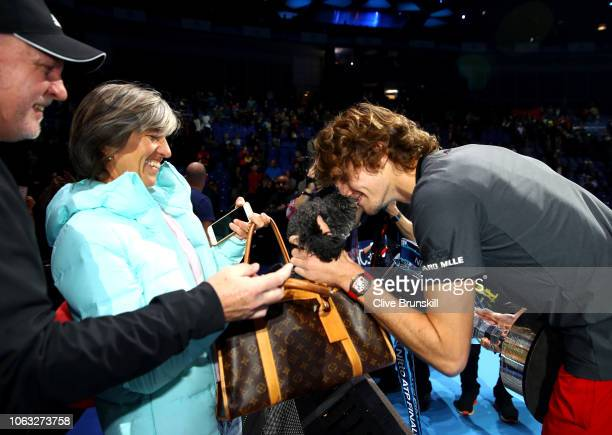 Alexander Zverev of Germany celebrates with his mum Irina Zvereva and the family dog following the singles final against Novak Djokovic of Serbia...