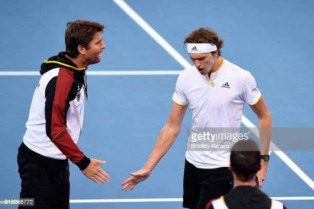 Alexander Zverev of Germany celebrates with team captain Michael Kohlmann after he defeated Alex de Minaur of Australia during the Davis Cup World...