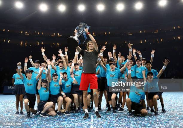 Alexander Zverev of Germany celebrates with the ball kids after the singles final against Novak Djokovic of Serbia during Day Eight of the Nitto ATP...