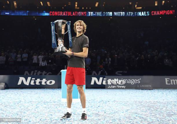 Alexander Zverev of Germany celebrates with the trophy after the singles final against Novak Djokovic of Serbia during Day Eight of the Nitto ATP...
