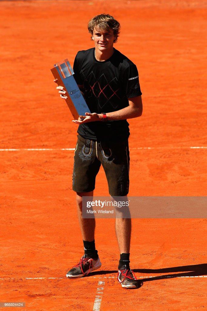 Alexander Zverev of Germany celebrates with the winner's trophy after beating Philipp Kohlschreiber of Germany during the final on day 9 of the BMW Open by FWU at MTTC IPHITOS on May 6, 2018 in Munich, Germany.
