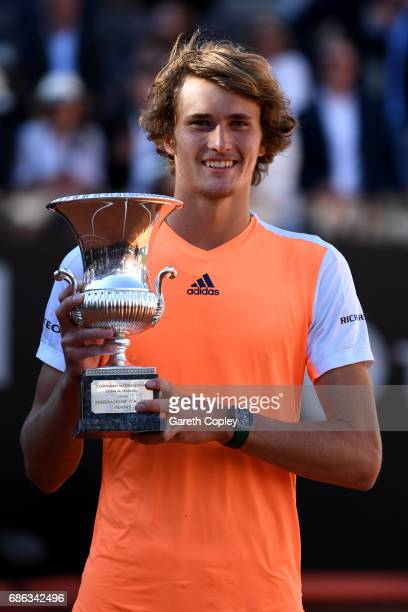 Alexander Zverev of Germany celebrates with trophy after beating Novak Djokovic of Serbia during the final of The Internazionali BNL d'Italia 2017 at...