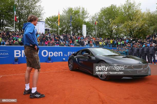 Alexander Zverev of Germany celebrates with winner's car BMW i8 after winning his finale match against Guido Pella of Argentina of the 102 BMW Open...