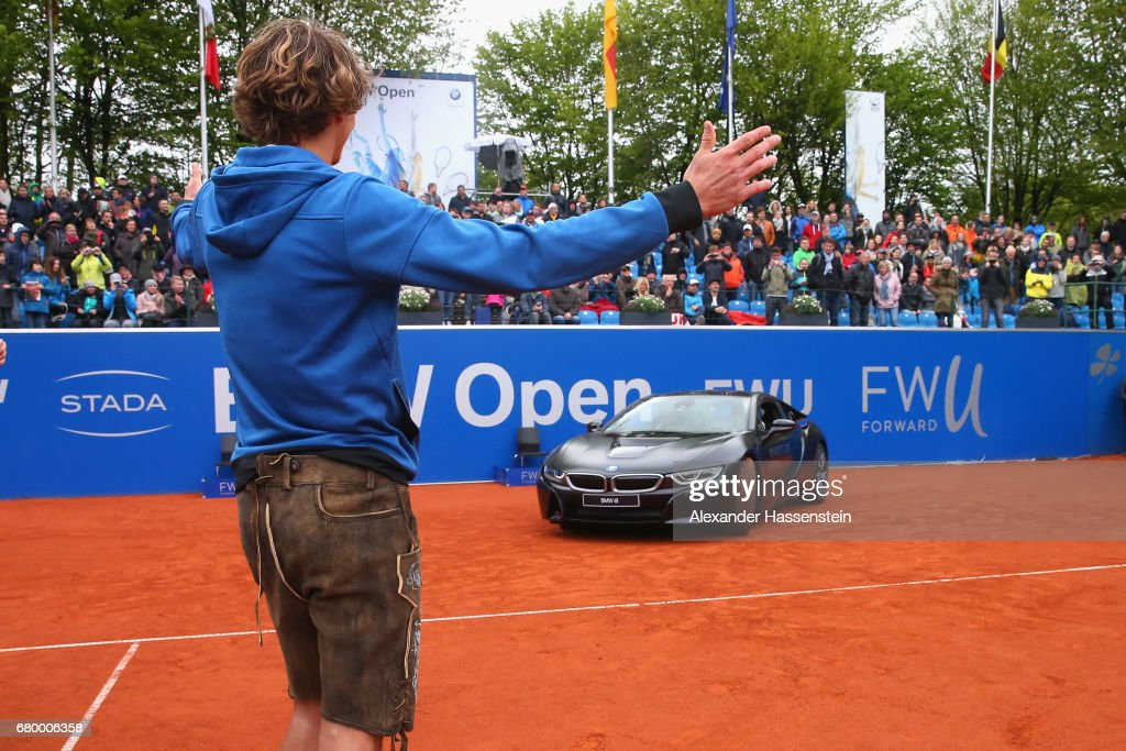 Alexander Zverev of Germany celebrates with winner's car BMW i8 after winning his finale match against Guido Pella of Argentina of the 102. BMW Open by FWU at Iphitos tennis club on May 7, 2017 in Munich, Germany.