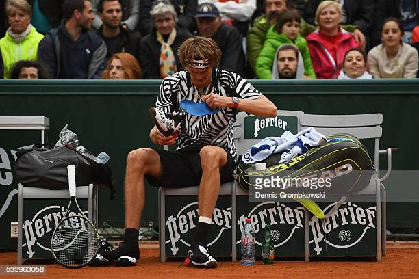 Alexander Zverev of Germany changes his shoes during the Men's Singles first round match against PierreHughes Herbert of France on day three of the...