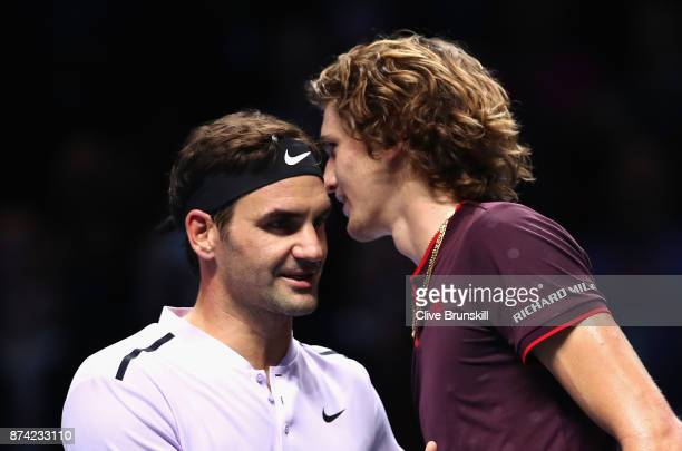 Alexander Zverev of Germany congratulates Roger Federer of Switzerland on victory following their singles match on day three of the Nitto ATP World...