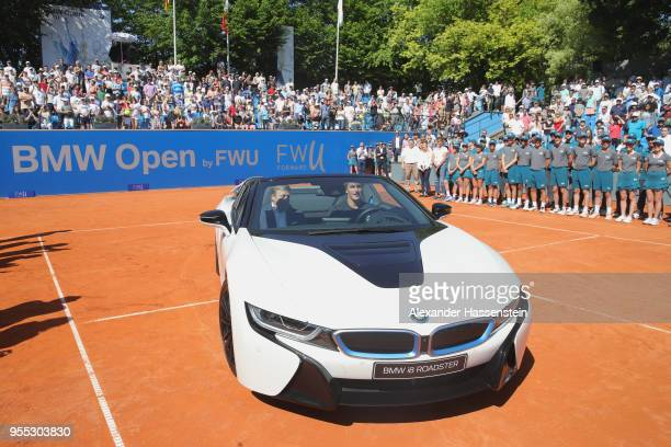 Alexander Zverev of Germany drives with Oliver Zipse member of the BMW Board the winners car a BMW i8 Roadster after winning his finalmatch against...
