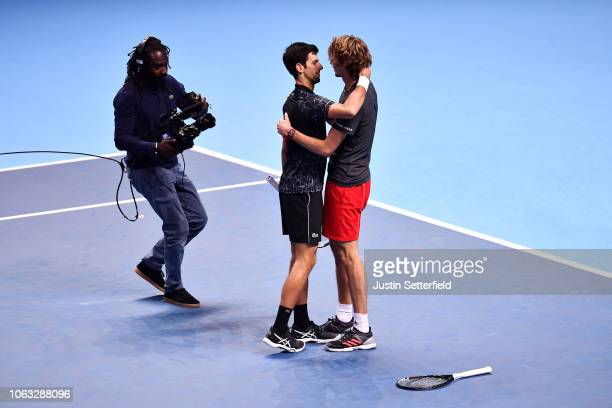 Alexander Zverev of Germany embraces with Novak Djokovic of Serbia after victory in the singles final during Day Eight of the Nitto ATP Finals at The...