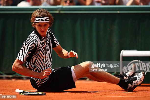 Alexander Zverev of Germany falls during the Men's Singles first round match against PierreHughers Herbert of France on day four of the 2016 French...