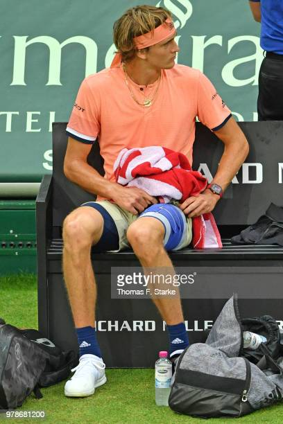 Alexander Zverev of Germany fixes his bandage in his match against Borna Coric of Croatia during day two of the Gerry Weber Open at Gerry Weber...