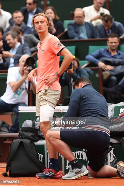 Alexander Zverev of Germany gets treatment for an injury during the mens singles quarter finals match against Dominic Thiem of Austria during day ten...