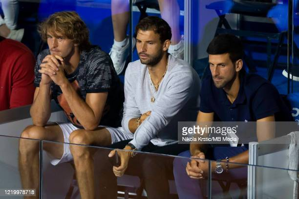 Alexander Zverev of Germany Grigor Dimitrov of Bulgaria and Novak Djokovic of Serbia watch the final match between Dominic Thiem of Austria and Filip...