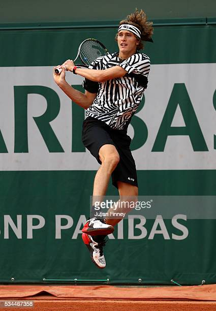 Alexander Zverev of Germany hits a backhand during the Men's Singles second round match against Pablo Carreno Busta and David Marrero of Spain on day...