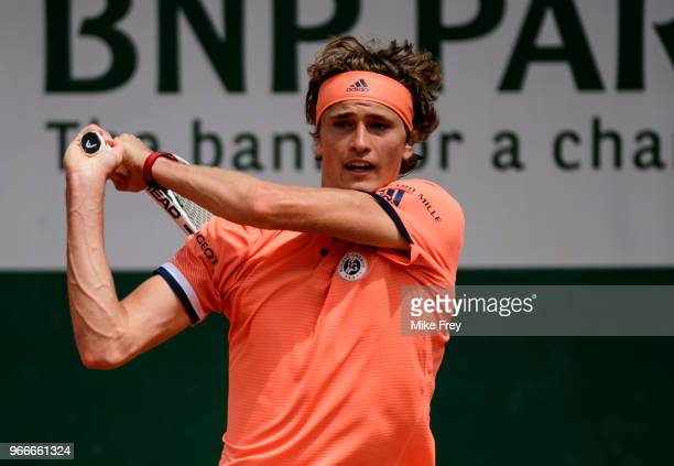 Alexander Zverev of Germany hits a backhand to Karen Khachanov of Russia in the fourth round of the men's singles at Roland Garros during the French...