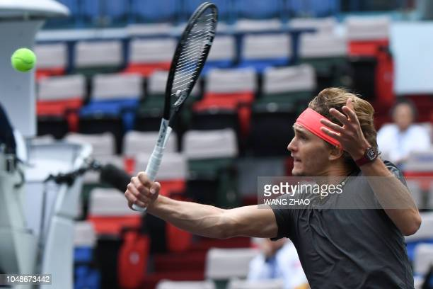 Alexander Zverev of Germany hits a return against Nikoloz Basilashvili of Georgia during their men's singles first round match at the Shanghai...