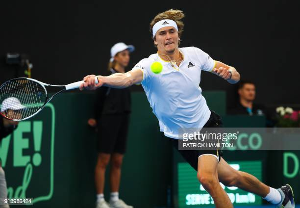 Alexander Zverev of Germany hits a return to Nick Kyrgios of Australia during their forth round rubber of the Davis Cup World Group tennis match at...