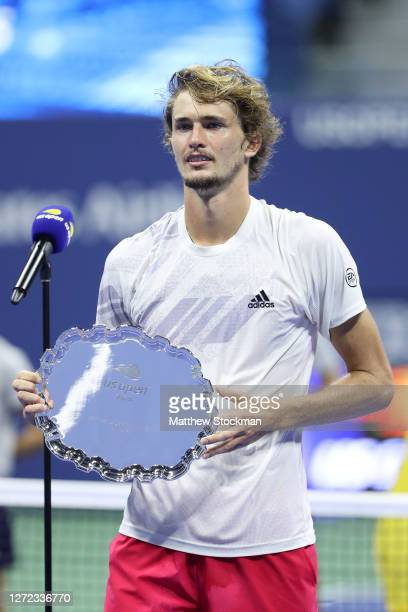 Alexander Zverev of Germany holds his finalist trophy after losing his Men's Singles final match against Dominic Thiem of Austria on Day Fourteen of...