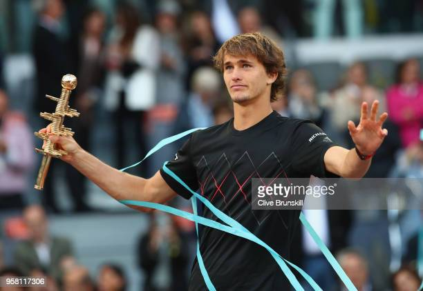 Alexander Zverev of Germany holds his winners trophy aloft after his straight sets victory against Dominic Thiem of Austria in the mens final during...
