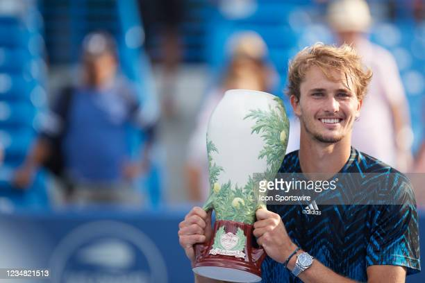 Alexander Zverev of Germany holds the Rookwood Cup after winning the mens championship match of the Western & Southern Open at the Lindner Family...