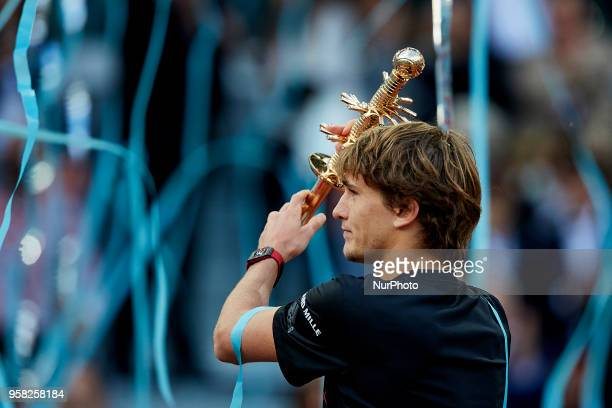 Alexander Zverev of Germany holds the trophy after winning the tournament in his final match against Dominic Thiem of Austria during day nine of the...