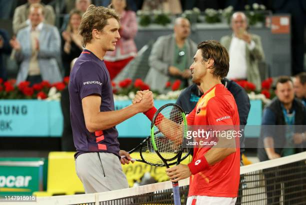 Alexander Zverev of Germany hugs David Ferrer of Spain after defeating him for his last match on tour during day 5 of the Mutua Madrid Open at La...