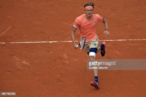 Alexander Zverev of Germany in action during his men's singles quaterfinal match against Dominic Thiem of Austria on day 9 of the 2018 French Open at...