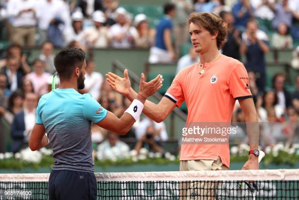 Alexander Zverev of Germany is congratulatd on victory by Damir Dzumhur of Bosnia and Herzegovinia following their mens singles third round match...