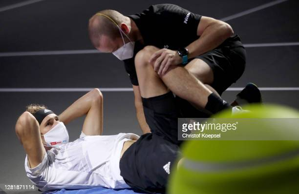 Alexander Zverev of Germany is treated after an injury during the match between Alexander Zverev of Germany and Adrian Mannarino of France of day...