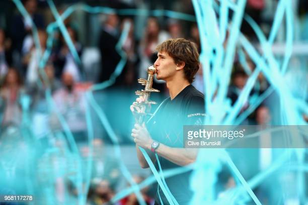 Alexander Zverev of Germany kisses his winners trophy after his straight sets victory against Dominic Thiem of Austria in the mens final during day...