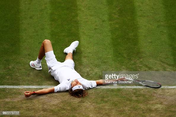 Alexander Zverev of Germany lays on the ground after an attempt on a return against Taylor Fritz of the United States duirng their Men's Singles...