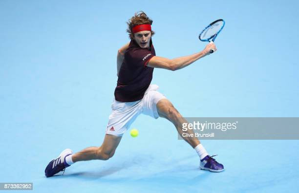 Alexander Zverev of Germany plays a backhand against Marin Cilic of Croatia in their round robin match during the Nitto ATP World Tour Finals at O2...