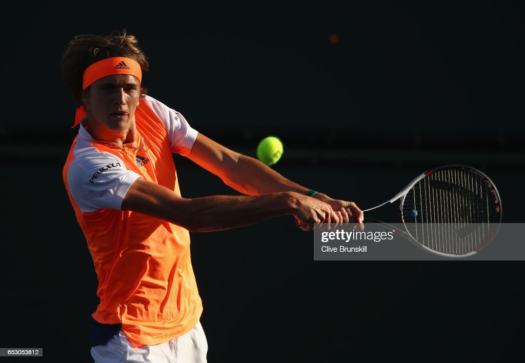 Alexander Zverev of Germany plays a backhand during his doubles match with brother Mischa Zverev against Henri Kontinen of Finland and John Peers of Australia during day eight of the BNP Paribas Open at Indian Wells Tennis Garden on March 13, 2017 in Indian Wells, California.