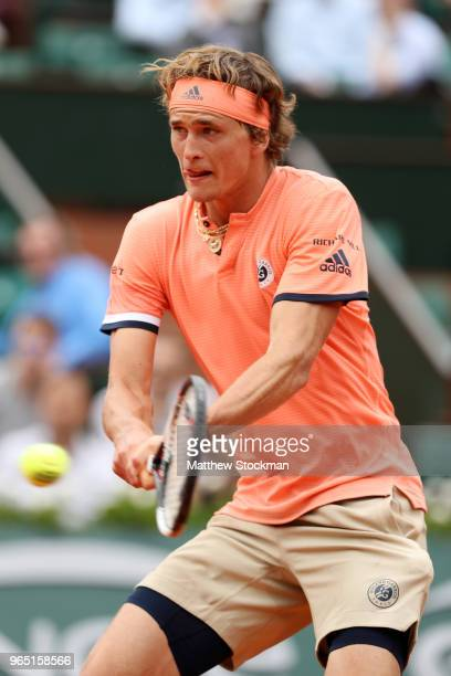 Alexander Zverev of Germany plays a backhand during his mens singles third round match against Damir Dzumhur of Bosnia and Herzegovinia during day...