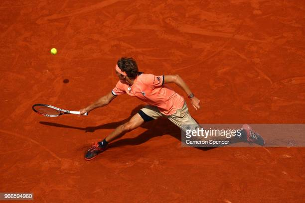 Alexander Zverev of Germany plays a backhand during the mens singles fourth round match against Karen Khachanov of Russia during day eight of the...