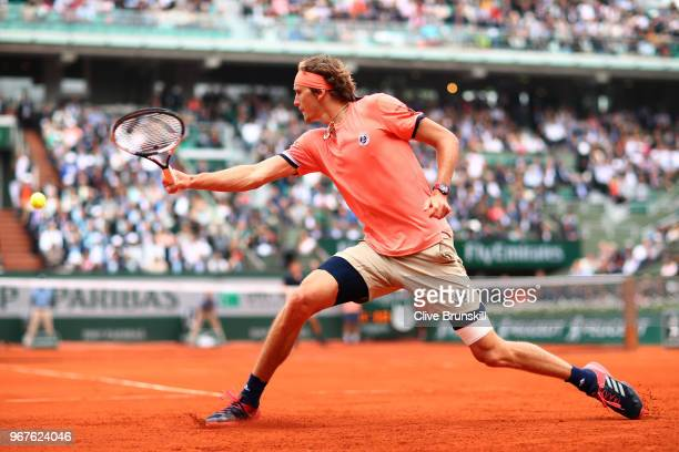 Alexander Zverev of Germany plays a backhand during the mens singles quarter finals match against Dominic Thiem of Austria during day ten of the 2018...
