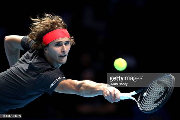 Alexander Zverev of Germany plays a backhand during the singles final against Novak Djokovic of Serbia during Day Eight of the Nitto ATP Finals at...