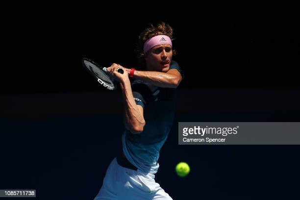 Alexander Zverev of Germany plays a backhand in his fourth round match against Milos Raonic of Canada during day eight of the 2019 Australian Open at...
