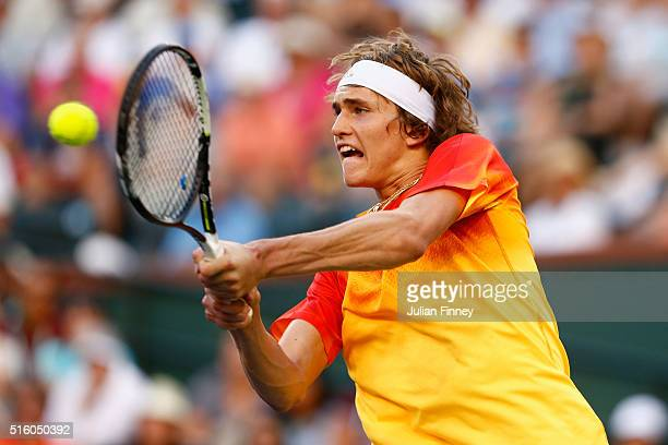 Alexander Zverev of Germany plays a backhand in his match against Rafael Nadal of Spain during day ten of the BNP Paribas Open at Indian Wells Tennis...