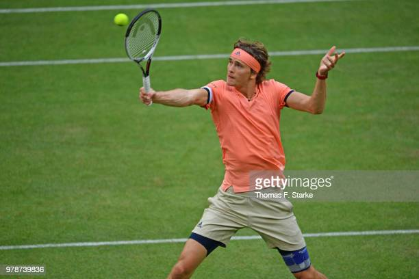 Alexander Zverev of Germany plays a backhand in his match against Borna Coric of Croatia during day two of the Gerry Weber Open at Gerry Weber...