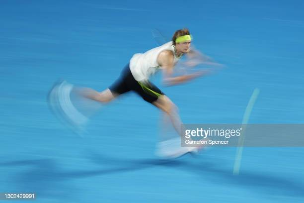 Alexander Zverev of Germany plays a backhand in his Men's Singles Quarterfinals match against Novak Djokovic of Serbia during day nine of the 2021...