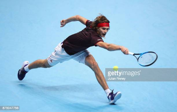 Alexander Zverev of Germany plays a backhand in his Singles match against Jack Sock of the United States during day five of the Nitto ATP World Tour...