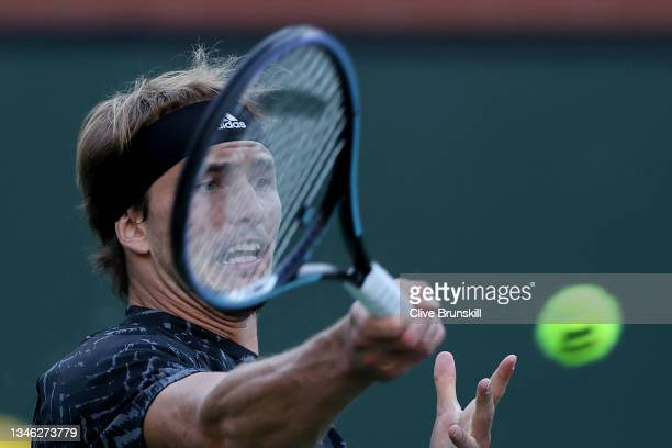 Alexander Zverev of Germany plays a forehand against Andy Murray of Great Britain during their third-round match on Day 9 of the BNP Paribas Open at...