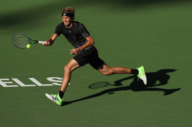 Alexander Zverev of Germany plays a forehand against Andy Murray of Great Britain during their third round match on Day 9 of the BNP Paribas Open at...