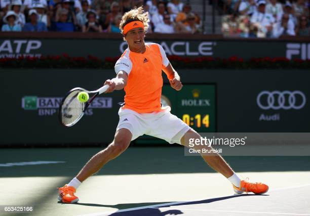 Alexander Zverev of Germany plays a forehand against Nick Kyrgios of Australia in their third round match during day nine of the BNP Paribas Open at...