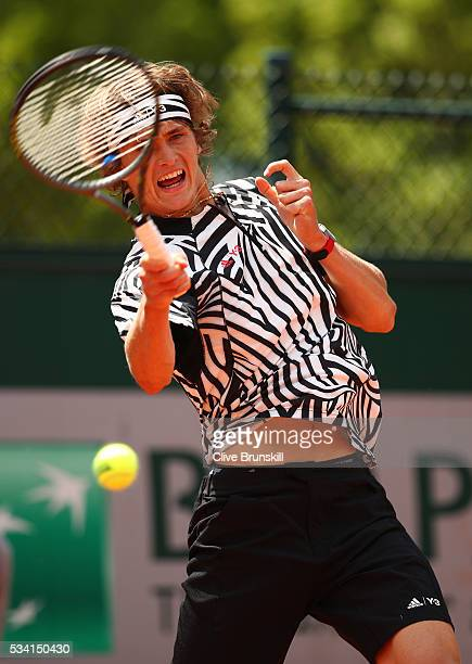 Alexander Zverev of Germany plays a forehand during the Men's Singles first round match against PierreHughers Herbert of France on day four of the...